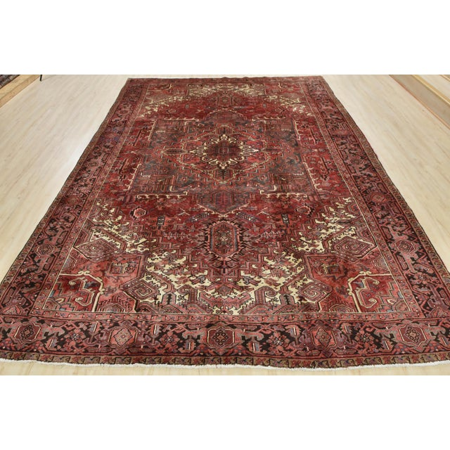 This is an authentic vintage Persian Heriz rug hand-knotted in Persia with an all wool pile with abrash on a cotton...