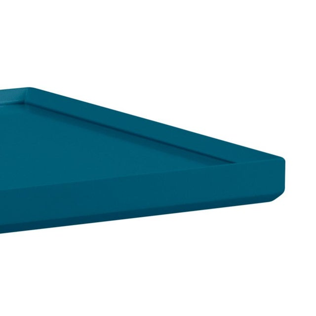 Made of acacia wood and topped with glass, our beveled spot table can do it all! Finish is Benjamin Moore Blue Danube.