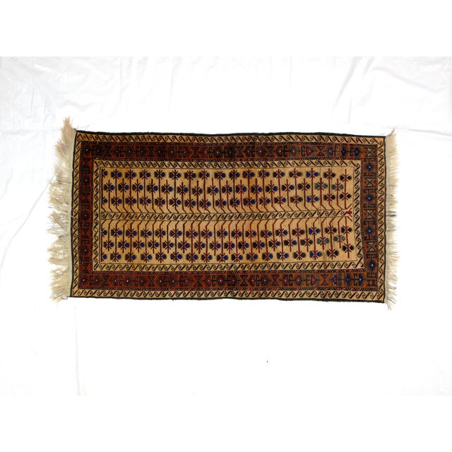 Wool on wool pile hand made beige Persian Baluch rug in excellent condition.