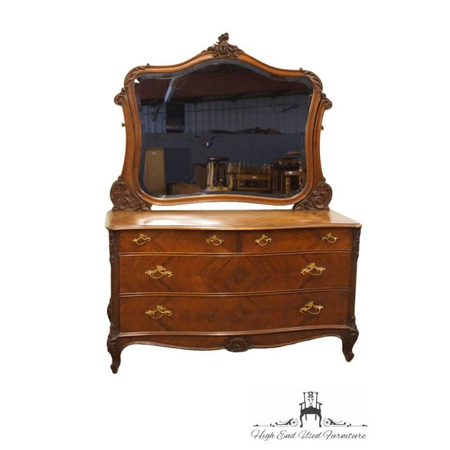 1920's Antique Louis XVI bookmatched mahogany four drawer dresser with mirror.