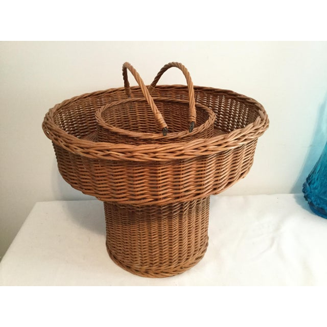 Large decorative basket with a wooden bottom.