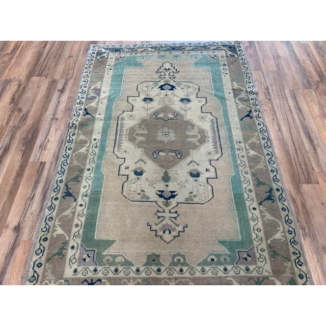 3'10x5'7 This Vintage Turkish Oushak is soft yet still full of life. The warm blues and earth tones compliment any room...