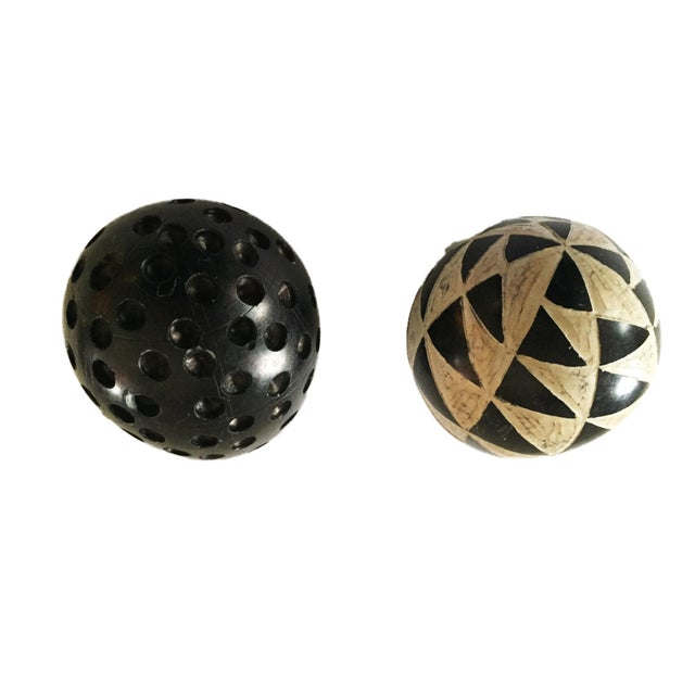 This listing is for one carved stone egg, which I believe is made of soapstone. The egg is black with a white carved...