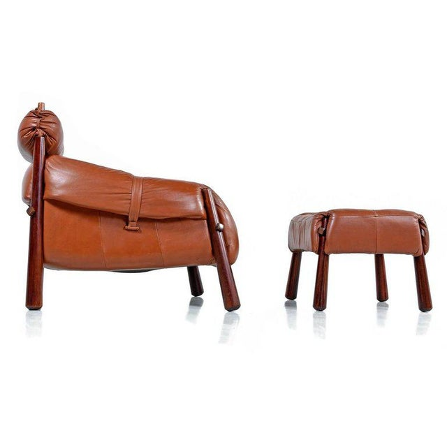Mid-Century Modern Brazilian rosewood / jacaranda lounge chair and ottoman by Brazilian designer Percival Lafer, 1960s....