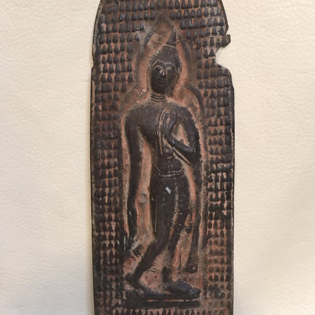 This item is from Thailand. I believe it was a cover for a window in a door. It is solid metal embossed in repose' with...