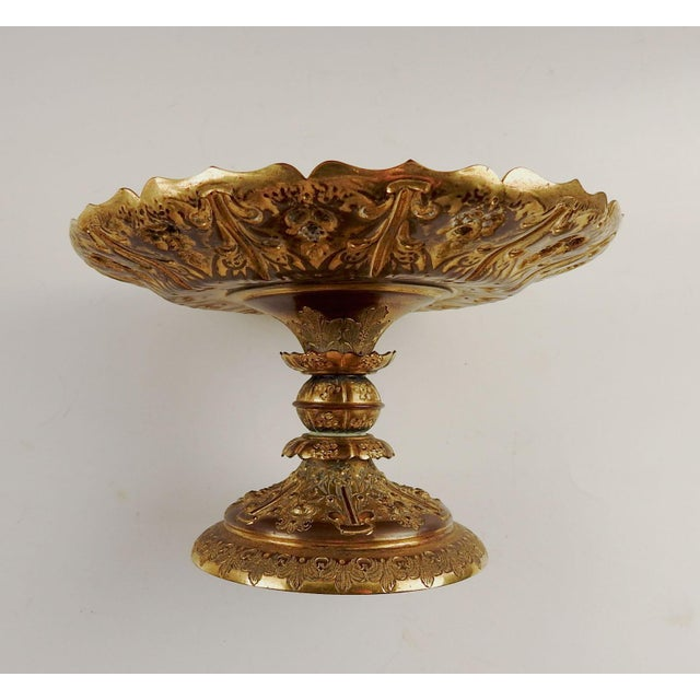 Circa 1890's gilt bronze highly decorated compote or footed dish. Weighted base, no markings, overall patina and wear.