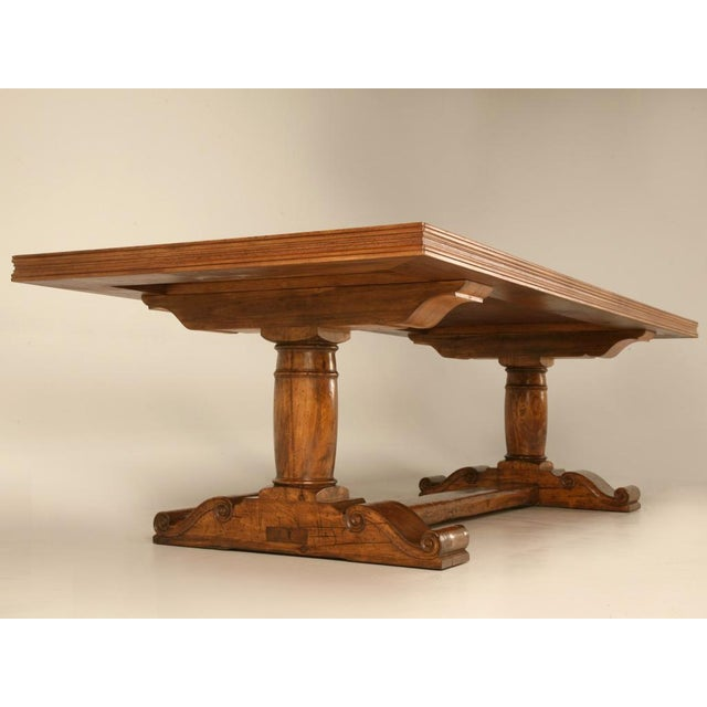 Handcrafted solid French trestle table constructed of aged solid walnut with a gorgeous black band and a fleur de lys...