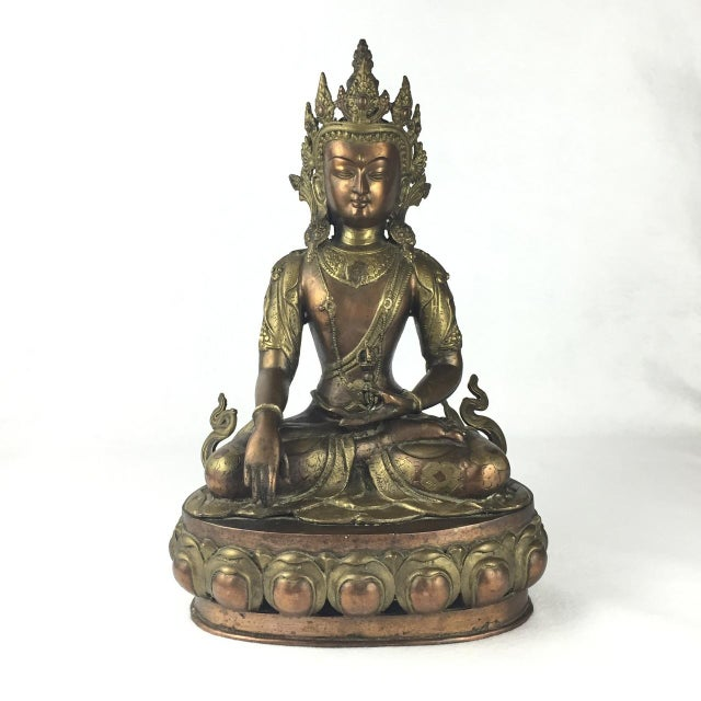 Vintage Tibetan Buddha Statue purchased in the 1950's. Gorgeous Buddha seated on a lotus flower. This heavy statue is in...