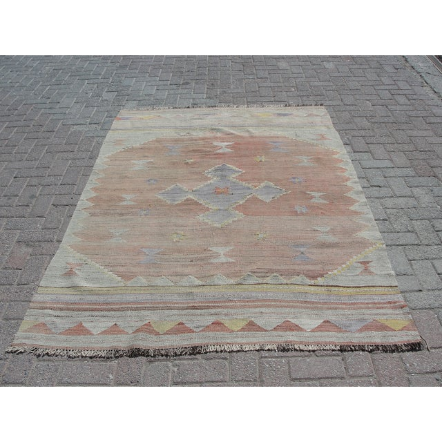 Vintage handwoven Turkish kilim rug. The kilim is nearly 75 years old. It is handmade, of very fine quality natural wool...