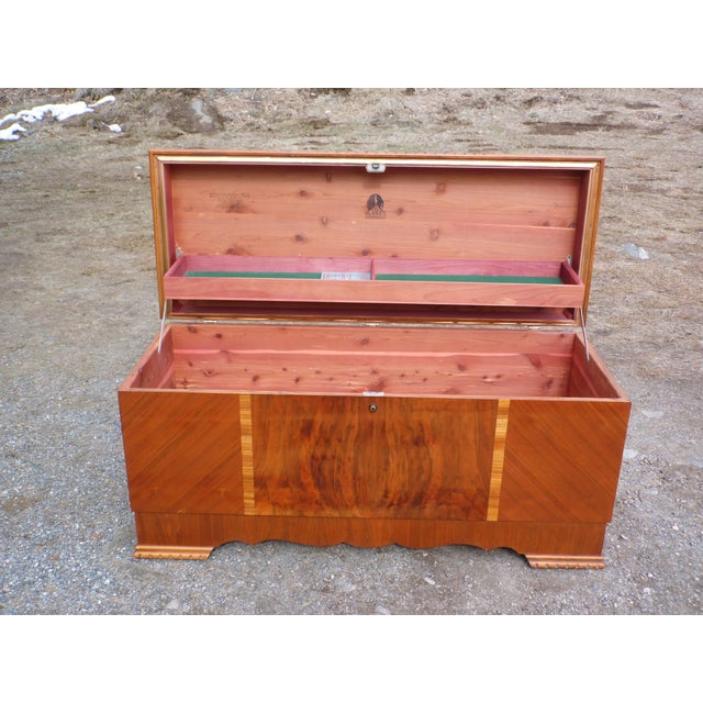 Stunning Art Deco Lane Walnut Cedar Trunk / Blanket Chest features a waterfall design with rounded front edge and corners,...