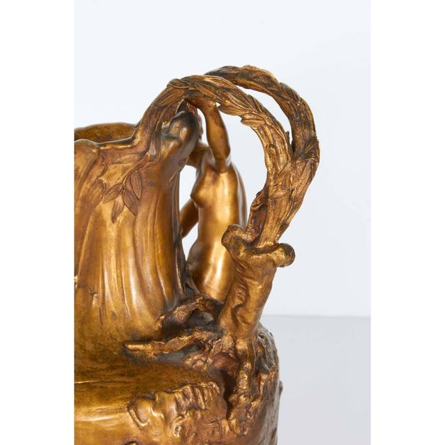 An Art Nouveau gilt bronze lobed ewer by Alexandre Vibert (French, 1847-1909), produced within the early 20th century...