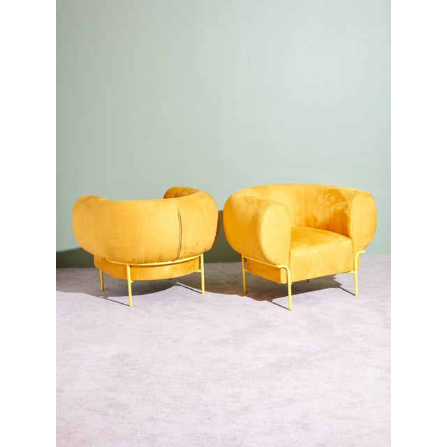 Yellow Madda Chairs by Michael Felix. Down and feather seats and dacron and foam wrapped arms. Powder coated legs. Made in...