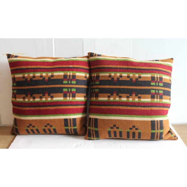 This pair of horse blanket pillows have wonderful color and a most unusual geometric pattern. Sold as a pair. The backing...