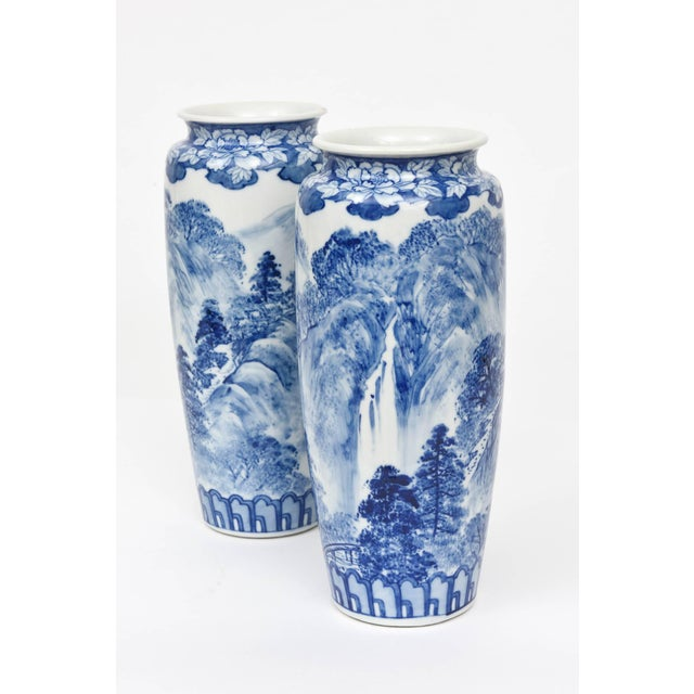 A classic blue and white porcelain pair of vases. Full scenic surround and signed on the bottom corners with full hall...