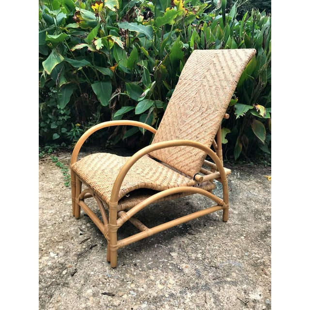 Vintage Rattan Bamboo Adjustable Chaise Lounge Chair. Back-rest adjustable in 3 different positions. It has a pull-out...