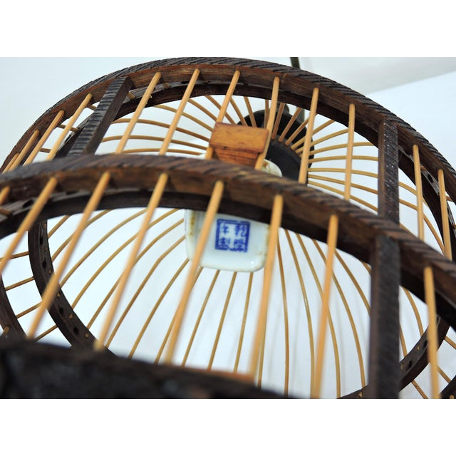 Vintage Chinese Bamboo Bird Cage With Porcelain Bowls, Cicadas & Dragon Decorations For Sale - Image 9 of 10