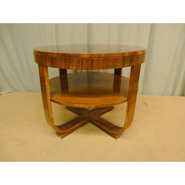 Northern European 1930's Art Deco walnut side table. Carefully restored to its original beauty.
