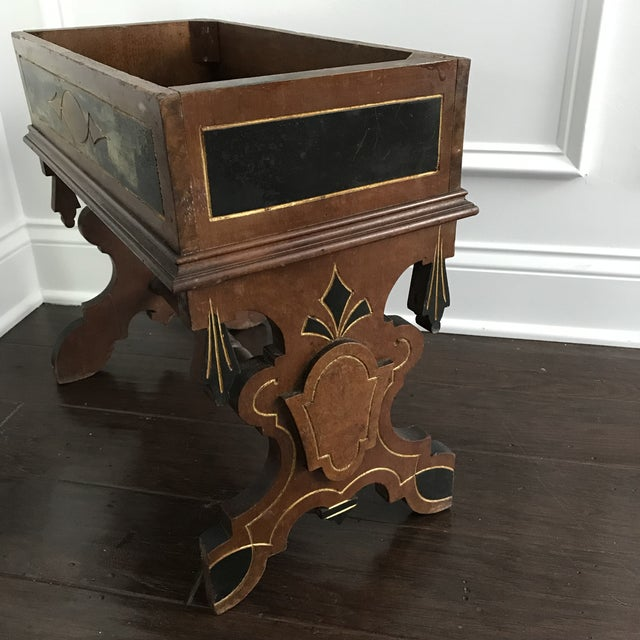 Gorgeous late 19th century wooden plant stand with black and gold accents. Would look really beautiful in a foyer or great...
