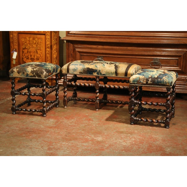 Elegant pair of antique stools with matching bench from Southern France; crafted, circa 1850, each fruitwood piece...