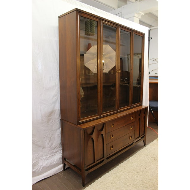 This gorgeous Broyhill Brasilia china cabinet is part of the Brasilia collection, inspired by the architecture of the City...
