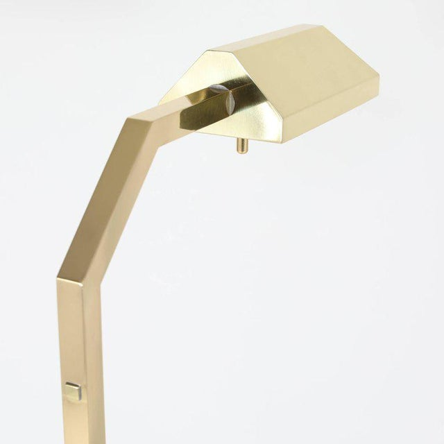 Pharmacy style brass reading floor lamps designed by Chapman in the 1970s, combining Industrial and Modern Design....
