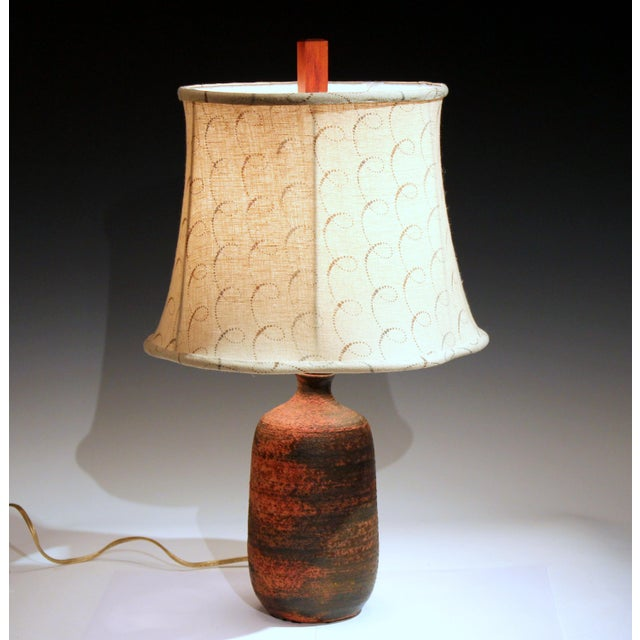 Vintage hand turned pottery lamp with great, tactile sandy lava texture and subtle Red/Brown coloration, circa mid 20th...