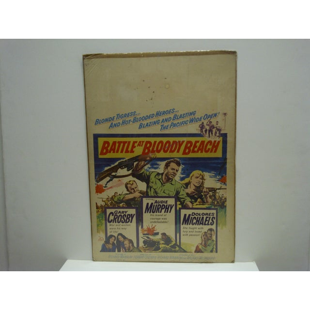 This is a Vintage -- Battle Of Bloody Beach Movie Poster -- Starring Audie Murphy -- The Poster Is In Fair Condition --...