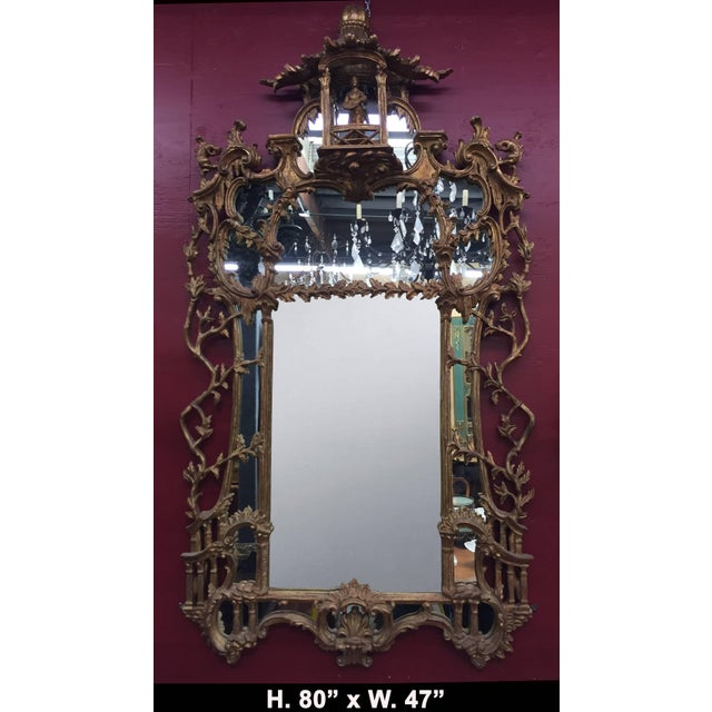 Exceptional 19th century George III style Chippendale style carved giltwood mirror. The work is surmounted by an...