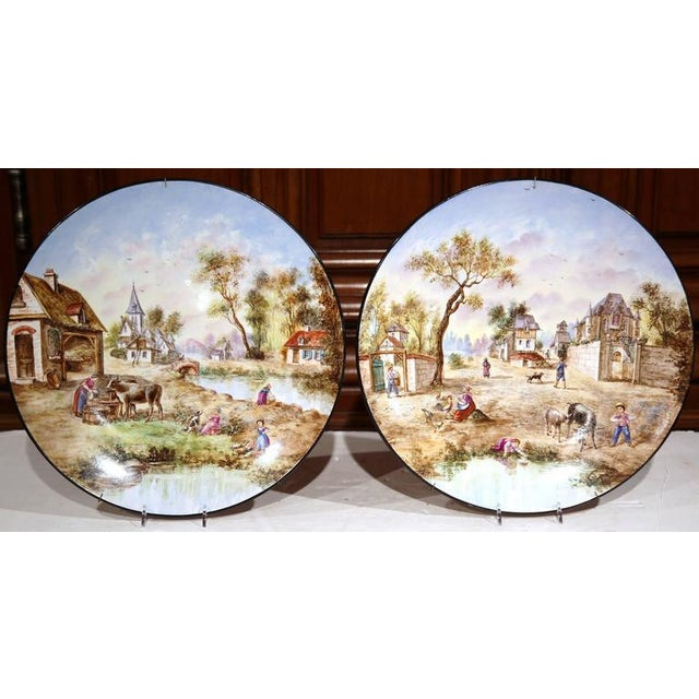 Early 20th Century French Hand-Painted Faience Wall Plates - A Pair For Sale - Image 5 of 10