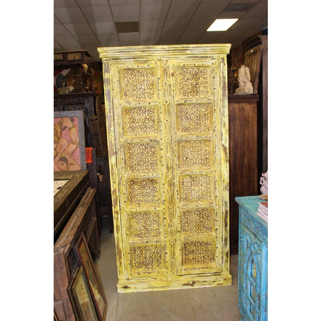 Anglo-Indian Vintage Yellow Antique Carved Detail Indian Armoire For Sale - Image 3 of 8