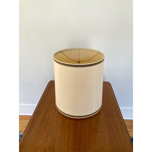 Large 1970s vintage Stiffel Lampshade. Ivory/beige colored textured silk with gold and black ribbon trim along top and...