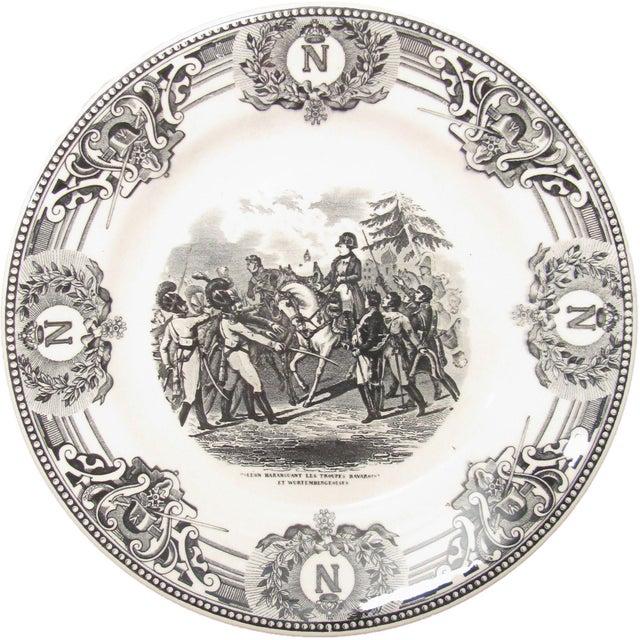 Elegant pair of Napoleon black & white transferware plates, C. 1920. Both feature a elaborate border of Napoleonic symbols...