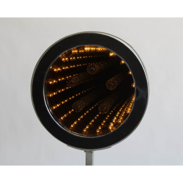 Stunning infinity mirror, circa 1977 creation by design team Curtis Jeré. A layer of glass over the internal lighting...