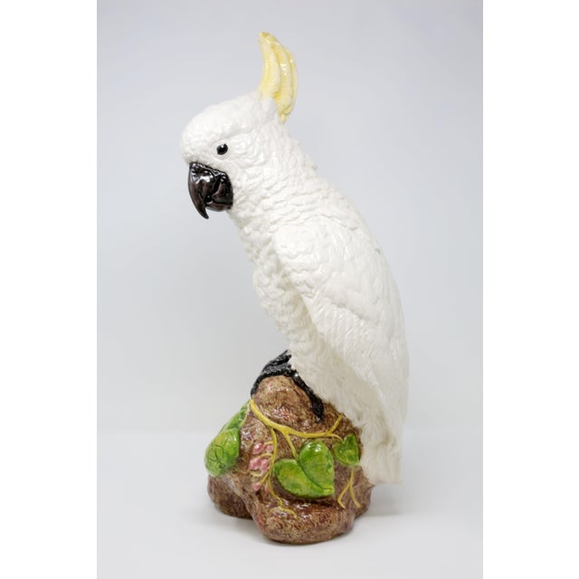 A quintessential piece of Palm Beach decor, this is a large, life-size and very detailed ceramic figure of a cockatoo! It...