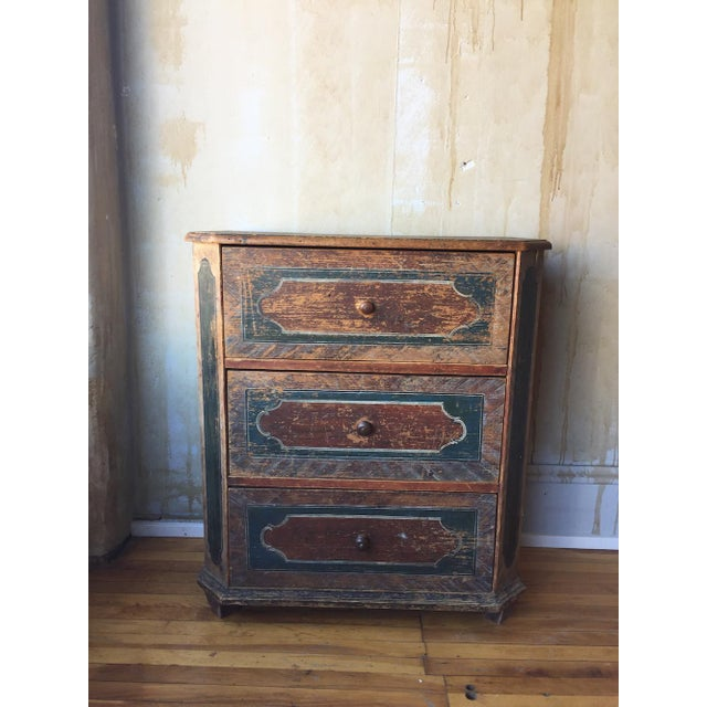 """This small painted and decorated """"arte povera"""" chest of drawers circa 1750 is from the northern Italy resort area called..."""