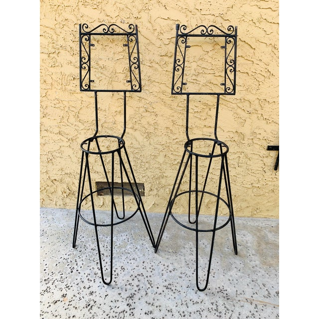 Great pair of barstools. Attributed to Frederick Weinberg or other mid century modern design mavens . The iron frames...