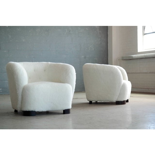 Incredibly comfortable, exuberant, and superbly made pair of Danish lounge chairs perfectly capturing the essence of 1940s...