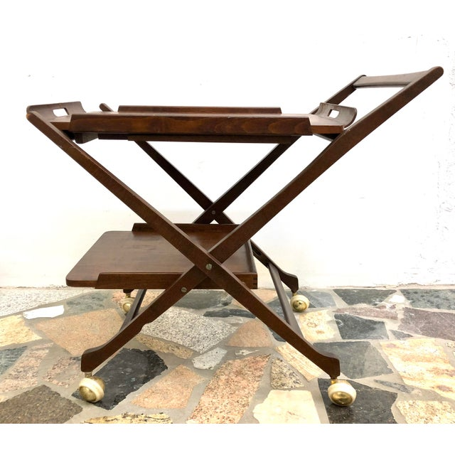 1960s era folding bar / tea cart in the Danish Style. Has removable tray with extending legs for serving. Rolls nicely on...