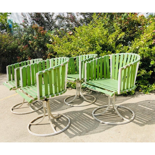 Fantastic Vintage White Wrought Iron Barrel Backed Swivel Outdoor Chairs with Modern Green Straps. Original finish...
