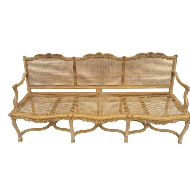A rare French classic, hand carved and caned 3 seat canape. settee, bench, sofa. Casual sophistication as only the French...