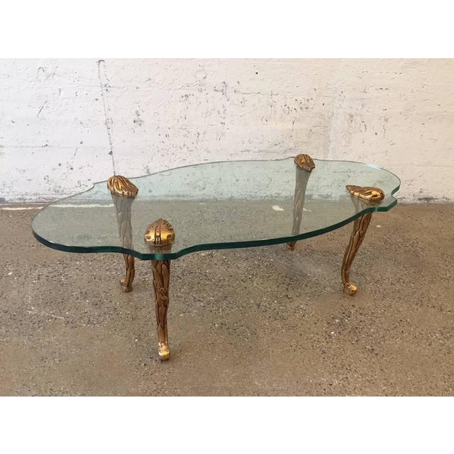 Giltwood and glass coffee table.