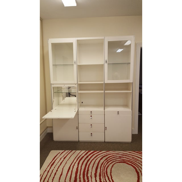 1978 Avanti Wall Unit by Dux of Sweden: White modular wall shelves with 2 glass door cabinets, 2 solid door cabinets and...