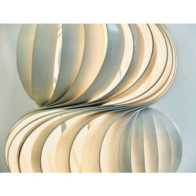 Olaf von Bohr, Austrian designer born in 1927. 'Medusa', lamps, model created in 1968. Composed of curved strips of white...
