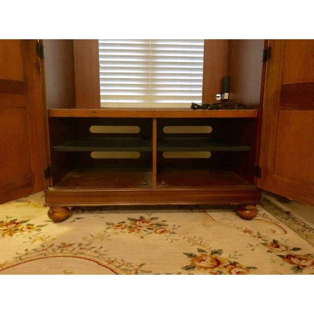 Beautiful solid wood armoire that's been loved for 20 years as a TV cabinet. Very well kept, elegant details, minimal...