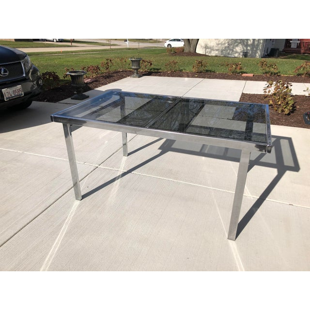 Impeccable vintage shape. The table has a hidden leaf that pops up when you extend both sides. The glass is original. I...