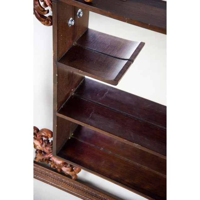 This Victorian mahogany decorative wall mirror with shelves really brings the classic vibe to any wall. The ancient...