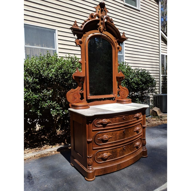 I'm very pleased to offer for sale this exquisite antique 3-drawer, marble top, walnut dresser and vanity mirror in the...
