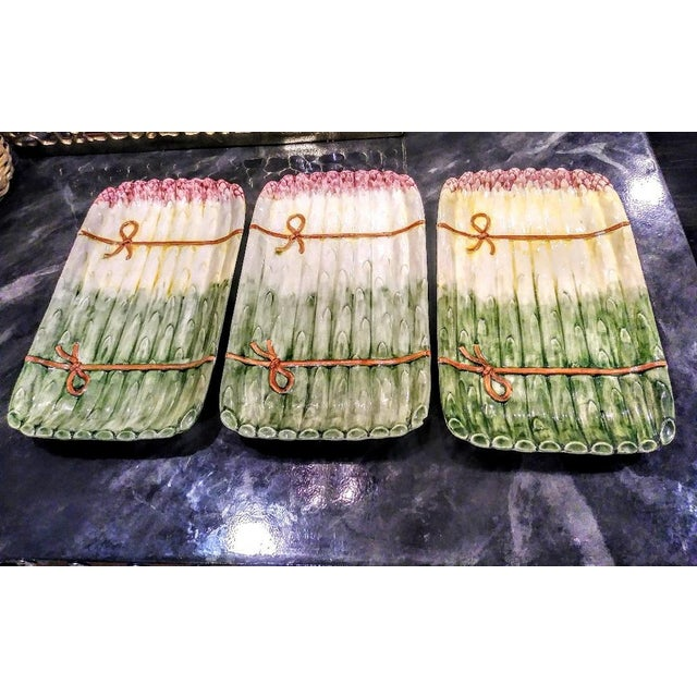 A set of 3 beautiful asparagus platters. They are made in Portugal, with pretty pink, yellow and green asparagus design...
