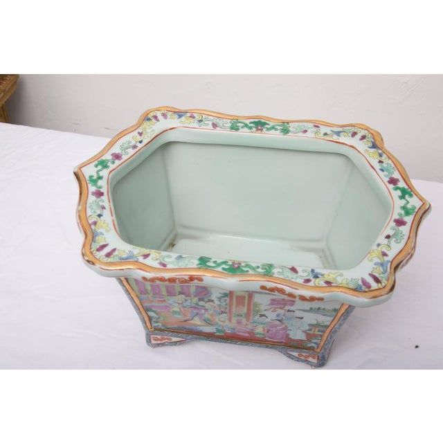 This stunning rose medallion rectangular ceramic jardiniere offers a sophisticated accessory for any fine interior. The...