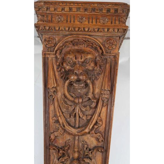 Pair of 19th c. English pine pedestals with finely carved lion head motif HEIGHT: 47 in. (119 cm) WIDTH: 13 in. (33 cm)...